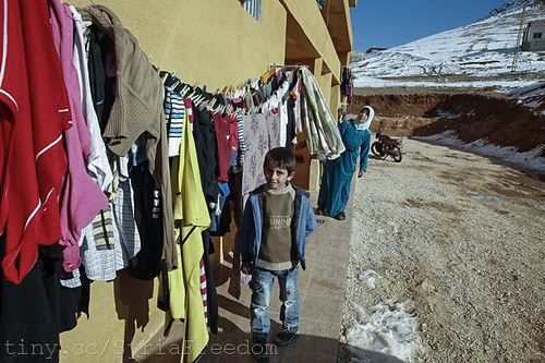 Syrian refugees, who fled the violence in Syria, are seen at a building hosting them temporaily, in the hillside town of Arsal in Lebanon's Bekaa Valley, March 5, 2012 Photo: FreedomHouse