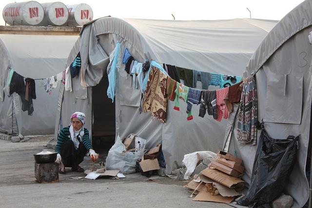 Syrian family at makeshift camp at former bulgur wheat factory, Suruc, south-eastern Turkey. Photo: Caroline Gluck/EU/ECHO