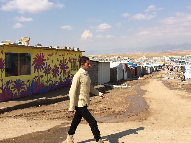 A man walks past a mural painted in a project run by AptART and ACTED in Domiz refugee camp, Dohuk, Kurdistan Region of Iraq. The project, bringing together street artists and refugee children, was funded by the European Commission's Humanitarian Aid and Civil Protection department, ECHO and UNICEF. Photo: EU/ECHO/Caroline Gluck