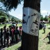 Parc situé face à la gare de Côme, où une forme de quotidien fait d'attente s'organise. Photo: Alberto Campi / We report, 2014