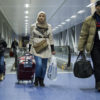 Nayef Buteh and his wife, Feryal Jabur and their son, Arab, 8, after arriving at Detroit Metropolitan Airport in Michigan, Nov. 19, 2015. The family was granted refugee status close to two years after they left Syria for a refugee camp in Jordan. A tide of anti-refugee sentiment has shaken the large Syrian community in Detroit.  *** Local Caption *** Migrants, demandeurs d'asile, famille, bagages, aeroport, transport  NORTH AMERICA MICHIGAN IMMIGRATION REFUGEES SYRIA DISPLACED PERSONS HUMAN RIGHTS